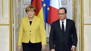 François Hollande et Angela Merkel à l'Elysée, à Paris, le 20 février 2015. (MIGUEL MEDINA / AFP)