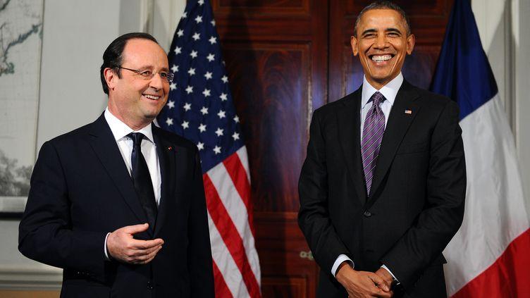 François Hollande etBarack Obama dans la résidence de l'ancien président américain Thomas Jefferson à Charlottesville (Virginie,Etats-Unis), le 10 février 2014. (JEWEL SAMAD / AFP)
