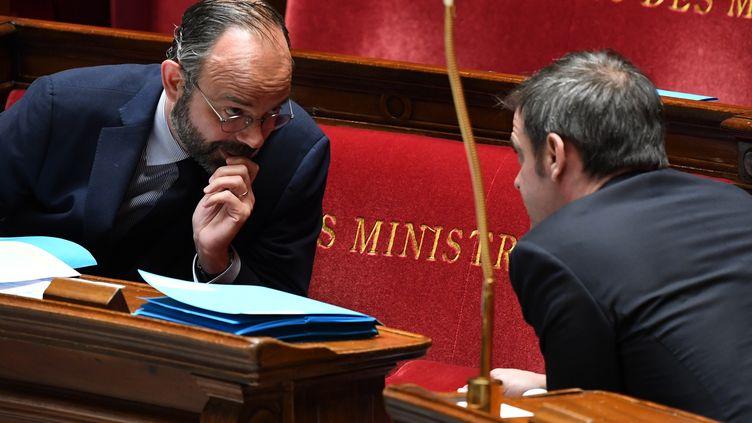 Edouard Philippe et Olivier Véran lors des questions au gouvernement à l'Assemblée nationale, le 7 avril 2020. (ALAIN JOCARD / AFP)