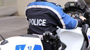 Un policer en moto, en décembre 2013 (Photo d'illustration). (ALEX BAILLAUD / MAXPPP)