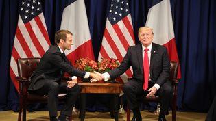 Emmanuel Macron et Dnald Trump, le 18 septembre 2017 à New York (Etats-Unis). (LUDOVIC MARIN / AFP)