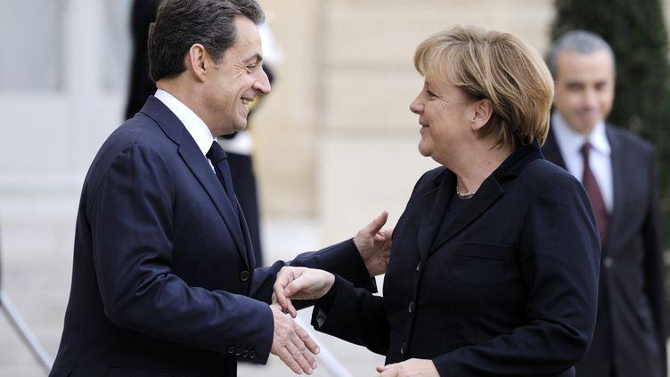 Le président français, Nicolas Sarkozy, et la chancelière allemande, Angela Merkel, à l'Elysée, à Paris, le 5 décembre 2011. (ERIC FEFERBERG / AFP)