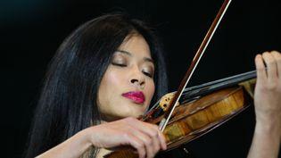 La violoniste Vanessa Mae lors d'un concert à Grozny (Tchétchénie), le 11 mai 2011. (SAID TCARNAEV / RIA NOVOSTI / AFP)