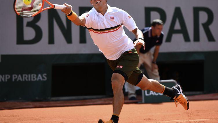 Le Japonais Kei Nishikori n'a rien lâché contre Fernando Ferdasco pour finalement s'imposer. (ERIC FEFERBERG / AFP)