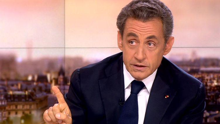 Nicolas Sarkozy, sur le plateau du journal de 20 heures de France 2, le 21 septembre 2014. (FRANCE 2 / AFP)