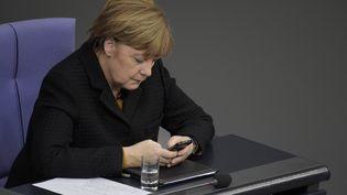 La chancelière allemande, Angela Merkel, au Bundestag à Berlin, le 16 décembre 2015. (ODD ANDERSEN / AFP)