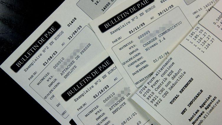 Une petite fille a reçu un salaire à deux ans ! Il s'agissait en fait d'une erreur de la banque. (MYCHELE DANIAU / AFP)