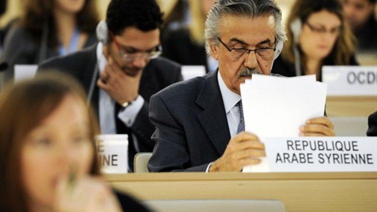 Le représentant de la Syrie, vendredi 29 avril, au Conseil des droits de l'Homme de l'Onu. (AFP - Fabrice Coffrini)