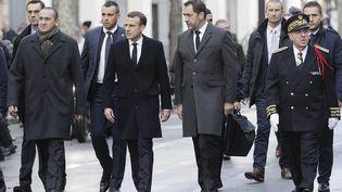 Emmanuel Macron avec Christophe Castaner, Michel Delpuech et Laurent Nunez, le 2 décembre 2018 à Paris. (GEOFFROY VAN DER HASSELT / AFP)