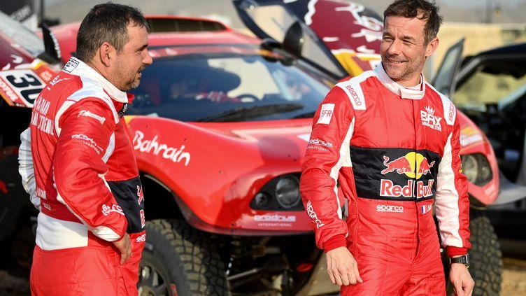 Daniel Elena et Sébastien Loeb complices lors du dernier Dakar, le 30 décembre 2020 (FRANCK FIFE / AFP)