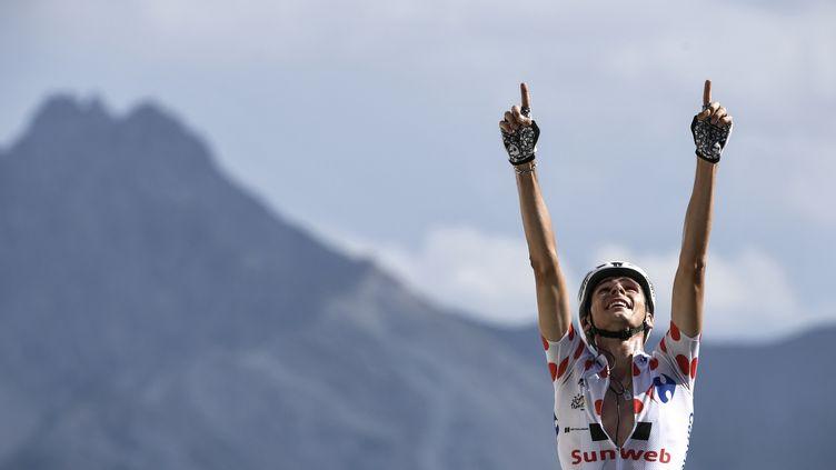 Warren Barguil a remporté la 18e étape du Tour de France en plus d'assurer son maillot à pois.  (PHILIPPE LOPEZ / AFP)