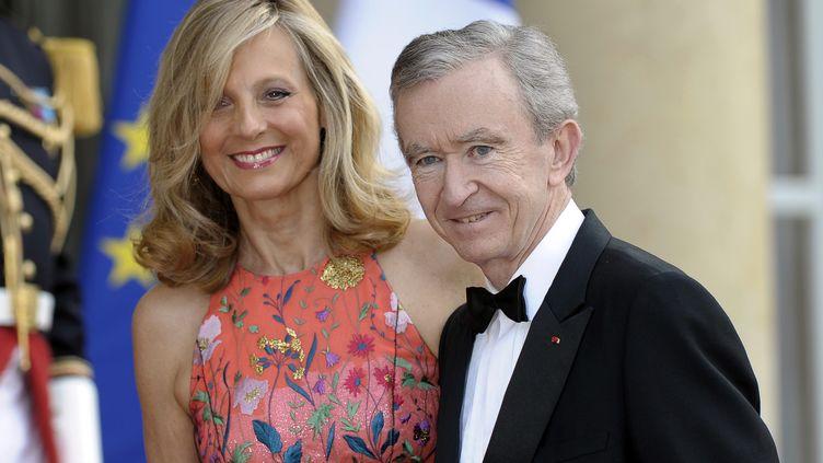 L'homme d'affaires Bernard Arnault et sa femme, le 6 juin 2014 à l'Elysée. (FRED DUFOUR / AFP)