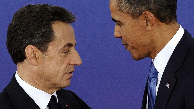Nicolas Sarkozy et Barack Obama pendant le début du G20 à Cannes le 3 novembre 2011. (JEWEL SAMAD/AFP)