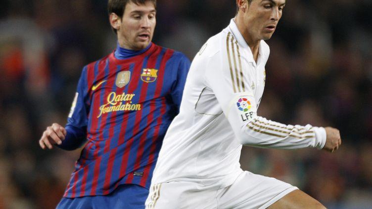 Le FC Barcelone de Lionel Messi et le Real de Cristiano Ronaldo seraient de très mauvais tirages pour l'OM. (ALBERT GEA / REUTERS)