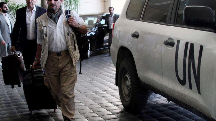 Un expert des Nations unies à Damas, le 25 septembre 2013, lors d'une mission d'enquête après l'attaque à l'arme chimique du 21 août. (AP / SIPA)