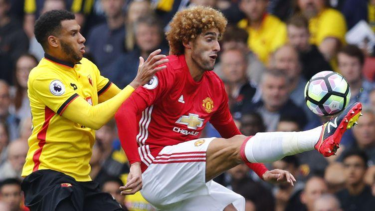 Etienne Capoue en duel avec Marouane Fellaini de Manchester United. (? REUTERS STAFF / REUTERS / X01095)