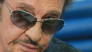 Johnny Hallyday, en conférence de presse à Moscou (Russie), le 25 mai 2012. (VITALIY BELOUSOV / RIA NOVOSTI / AFP)