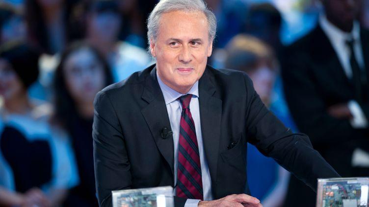 L'ancien secrétaire d'Etat Georges Tron au Grand Journal de Canal +, le 11 mai 2012. (BERTRAND LANGLOIS / AFP)
