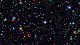 Combinaison d'images infrarouge fournies par Spitzer et d'images du télescope JaponaisSubaru,fournie par la Nasa, le 11 septembre 2014. (HANDOUT / NASA / AFP)