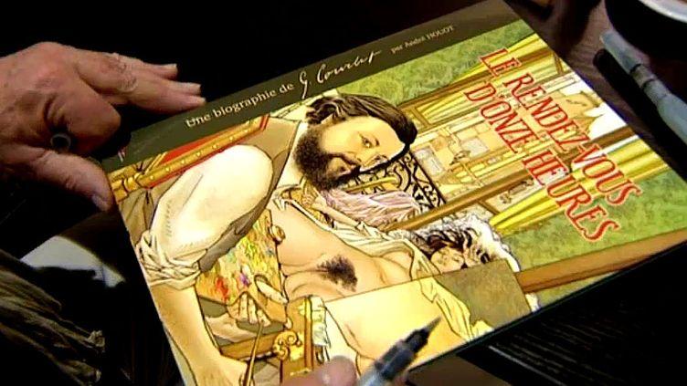 """Séance de dédicace pour André Houot, auteur de la bande dessinée consacrée à Courbet """"Le rendez vous de onze heures""""  (France 3 / Culturebox)"""