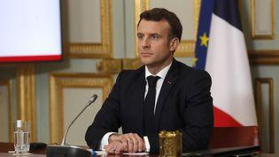 Emmanuel Macron durant une réunion en visioconférence du G7, le 19 février 2021. (THIBAULT CAMUS / AFP)