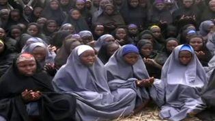 Un an après l'enlèvement des lycéennes nigérianes, 219 sont toujours portées disparues. ( BOKO HARAM / AFP)