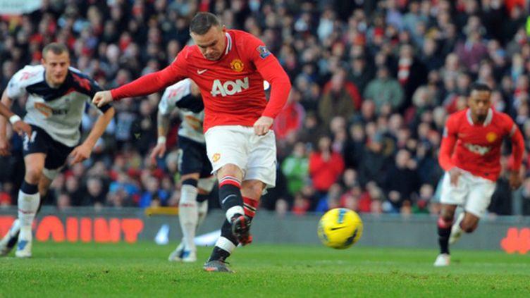 La joie de Wayne Rooney et des Mancuniens (ANDREW YATES / AFP)