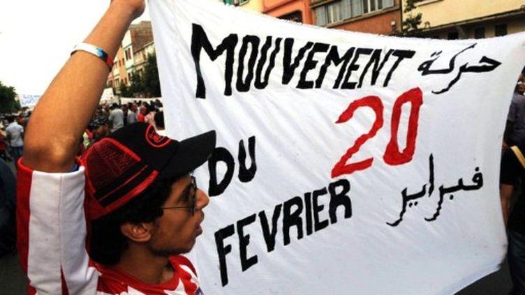 Banderole du Mouvement du 20 février, lors d'une manifestation pour la démocratie, à Casablanca le 3 juillet 2011. (AFP - Abdelhak Senna)