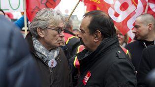 Le secrétaire général de FO, Jean-Claude Mailly (à gauche) et celui de la CGT, Philippe Martinez, lors d'une manifestation le 26 janvier 2016, à Paris. (CITIZENSIDE / PATRICE PIERROT / AFP)