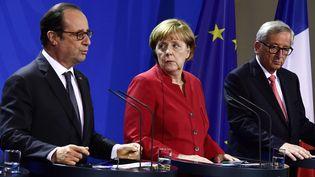 François Hollande, Angela Merkel et Jean-Claude Juncker, le 28 septembre 2016 à Berlin (TOBIAS SCHWARZ / AFP)