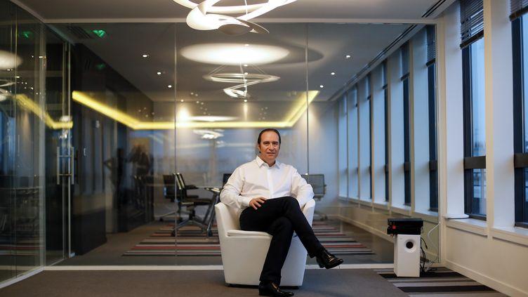 Xavier Niel, avant le lancement d'une nouvelle offre Free Mobile, le 10 janvier 2012, à Paris. (THOMAS COEX / AFP)