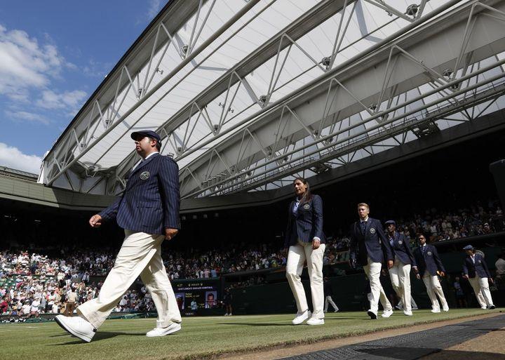 Des juges de ligne lors de l'édition 2019 de Wimbledon (ADRIAN DENNIS / AFP)