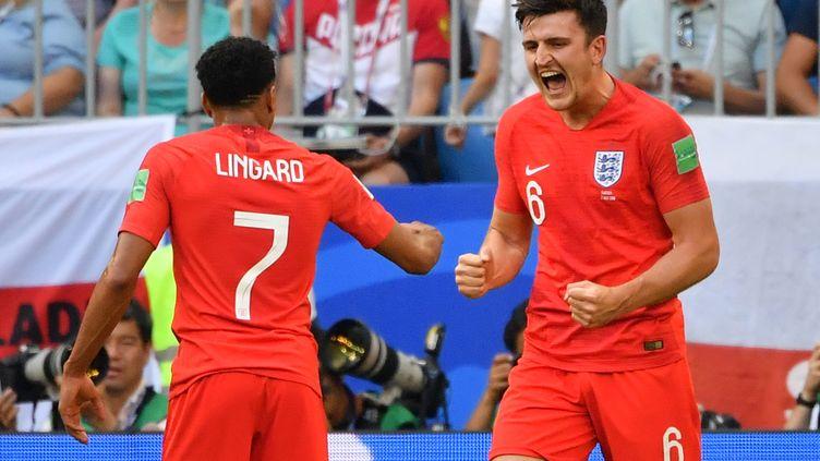 L'Anglais Harry Maguire célèbre son but en quart de finale face à la Suède, le 7 juillet 2018. (EMMANUEL DUNAND / AFP)