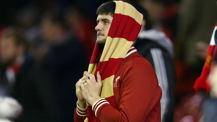 Un supporter du Liverpool FC abattu après l'élimination de son club en Ligue des champions (MATT WEST / BACKPAGE IMAGES LTD)