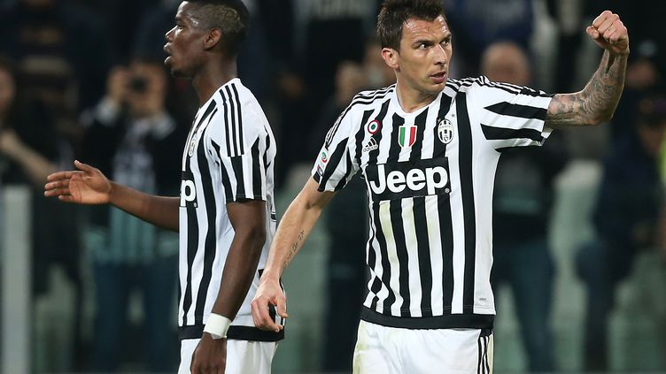 Pogba et Mandzukic, hommes clés de la Juve (MARCO BERTORELLO / AFP)