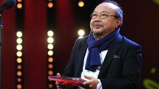 """Le réalisateur cambodgien Rithy Panh, ici en février 2020 à la Berlinale où il était récompensé pour son film """"Irradiés"""". (ABDULHAMID HOSBAS / ANADOLU AGENCY / AFP)"""
