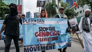Des Indonésiens manifestent contre la répression de la Chine envers les Ouïghours devant l'ambassade de Chine à Jakarta, Indonésie, le 21 décembre 2018. (ANTON RAHARJO / ANADOLU AGENCY)