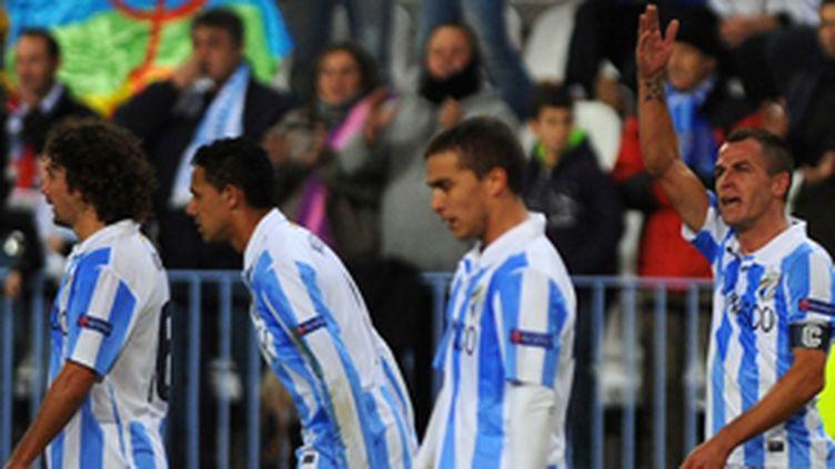 Les joueurs de Malaga protestent (JORGE GUERRERO / AFP)