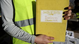 C'est sur ces cahiers de doléances que s'appuiera le grand débat promis par le gouvernement. (VALERY HACHE / AFP)