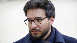 Le vice-président de l'association 13 novembre : Fraternité et vérité, Emmanuel Domenach, quitte l'Elysée, à Paris, le 21 mars 2016. (MAXPPP)