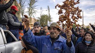 Manifestation à Figuig (Maroc) le 18 mars 2021,après l'interdictionpourles ressortissants marocains d'exploiter la palmeraie algérienne d'El Arja. (FADEL SENNA / AFP)