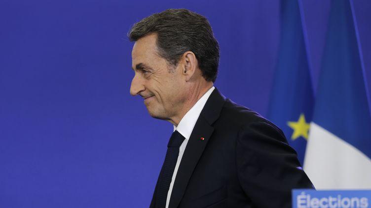 Le président de l'UMP, Nicolas Sarkozy, s'exprime au siège du parti, à Paris, au soir du second tour des élections départementales, le 29 mars 2015. (CHRISTIAN HARTMANN / REUTERS)