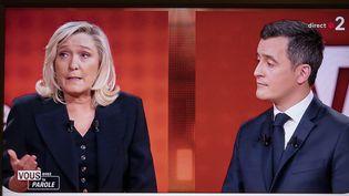 """Le ministre de l'Intérieur Gérald Darmanin et la présidente du Rassemblement national Marine Le Pen, sur le plateau de l'émission """"Vous avez la parole"""", le 11 février 2021 à Paris. (LAURE BOYER / HANS LUCAS / AFP)"""