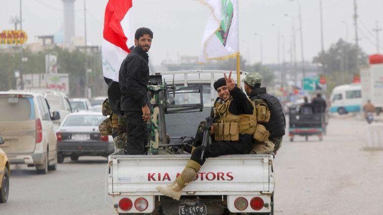 Des miliciens chiites en Irak, le 20 mars 2015. (  REUTERS)