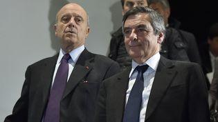 Alain Juppé et François Fillon, le 25 janvier 2017, à Bordeaux. (GEORGES GOBET / AFP)