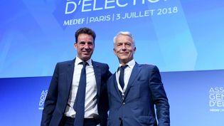 Le président et le vice-président du Medef, Geoffroy Roux de Bezieux et Patrick Martin, le 3 juillet 2018, à Paris. (ERIC PIERMONT / AFP)