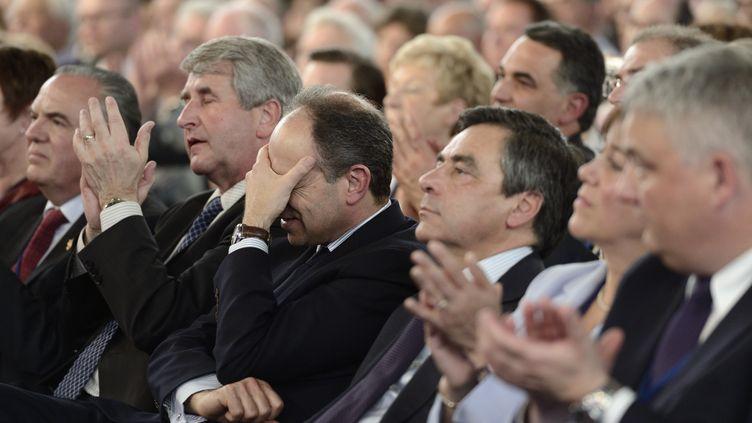 Jean-François Copé, alors secrétaire général de l'UMP, et François Fillon, Premier ministre de l'époque, le 25 avril 2012 à Cernay (Haut-Rhin). (ERIC FEFERBERG / AFP)