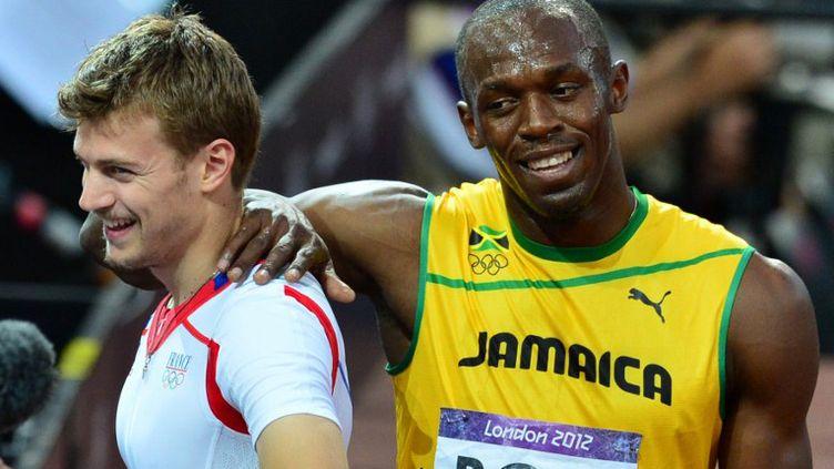 Christophe Lemaitre et Usain Bolt (GABRIEL BOUYS / AFP)