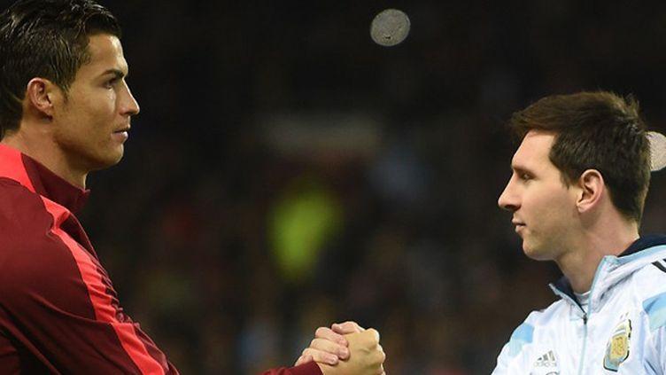 Cristiano Ronaldo et Lionel Messi (Portugal-Argentine) (PAUL ELLIS / AFP)
