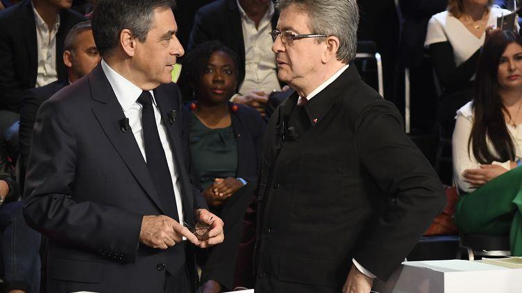 """Jean-Luc Mélenchon et François Fillon lors du """"Grand Débat"""", mardi 4 avril 2017. (LIONEL BONAVENTURE / POOL / AFP)"""